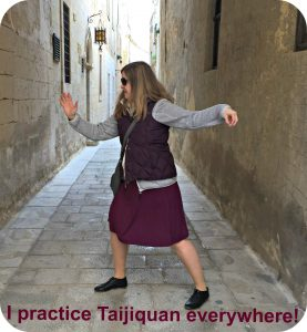 Angelika (blogger at Qialance) practices Taijiquan in old street of Mdina (Malta)