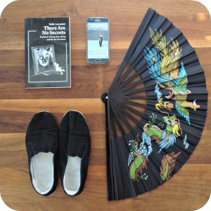 Picture of what one might need to preserve the art of Taijiquan: shoes, weapons, books, technology