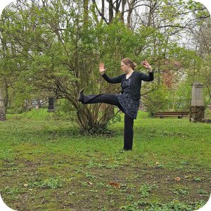 what is Tai Chi Chuan or Taijiquan: blogger Angelika (Qialance) showing a kick