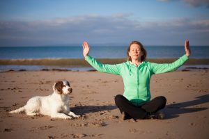 Janice Tucker from Space to Relax practicing Qi Gong at the beach